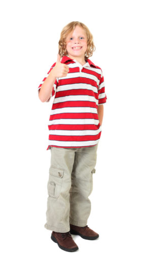 boy looking at camera with thumb up